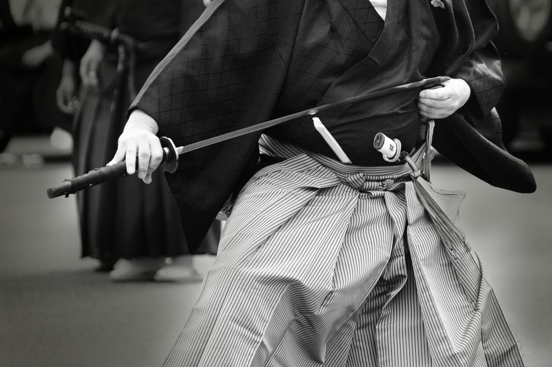 Samurai with sword practicing