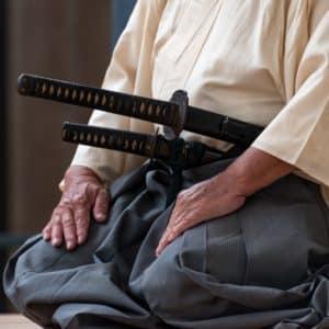 Samurai with daisho set of katana and wakizashi meditating about the Bushido code